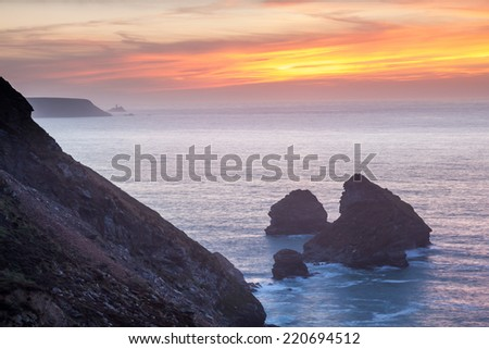 Sunset over cliffs at Bassetts Cove North Cliffs Cornwall England UK Europe