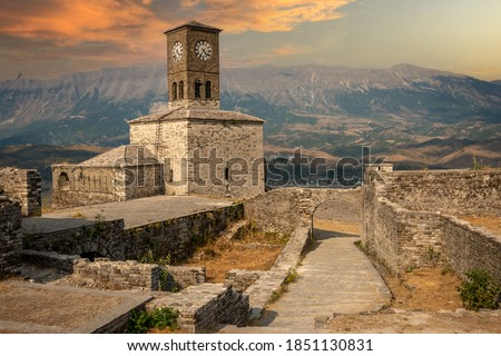 Sunset over clock tower and fortress at Gjirokaster, a beautiful town in Albania where the Ottoman legacy is clearly visible. High above the town the huge castle offers panoramic views. Stock photo ©
