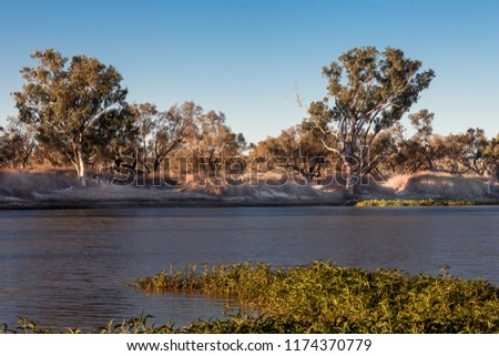 Sunset over Cooper Creek in outback Australia. #1174370779