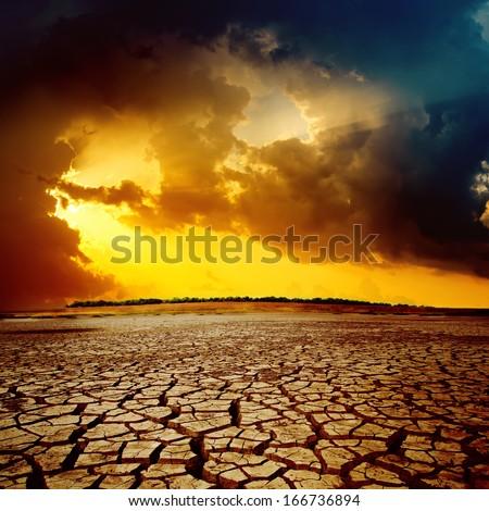 sunset over cracked desert
