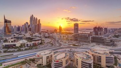Sunset over Dubai Media City with Modern buildings aerial timelapse, United Arab Emirates. Dubai marina on a background with traffic on a road