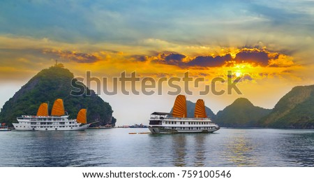 Sunset over Ha Long bay islands Halong mountains in South China Sea, Vietnam. UNESCO World Heritage Site Asia. #759100546