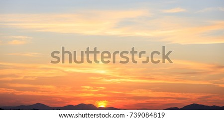 Sunset over hills silhouette, scattered clouds on the sky #739084819