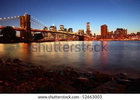 Sunset over historic Brooklyn Bridge in New York City