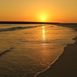Sunset over Jumeira beach in Dubai. Warm weather.