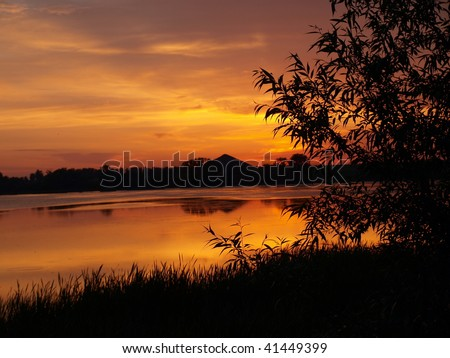 Sunset over lake in mountains