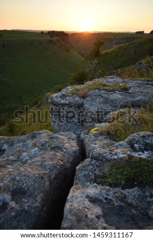 Sunset Over Limestone Rocks Above a Dale in the White Peak, Peak District National Park, UK