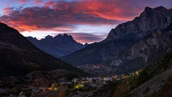 Sunset over Mont Pelvoux in the massif of the Ecrins National Park and the village of Les Vigneaux. Vallouise Valley, Hautes-Alpes, French Alps, France