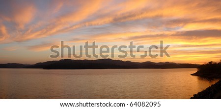 sunset over moutains and lake