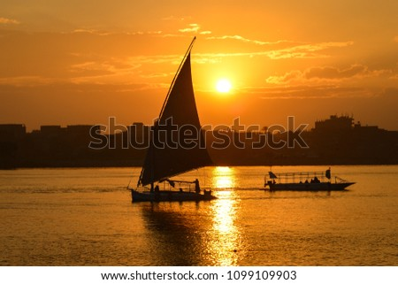 Sunset over Nile river with the pleasure boats silhouettes - Cairo, Egypt