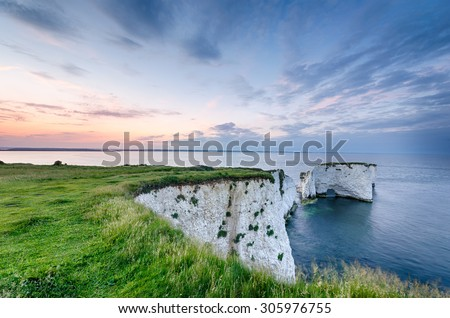 Sunset over Old Harry Rocks near Swanage and the start of the Jurassic Coast in Dorset #305976755