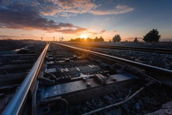 Sunset Over Railway Tracks, Low Perspective with Detail View of Scene.