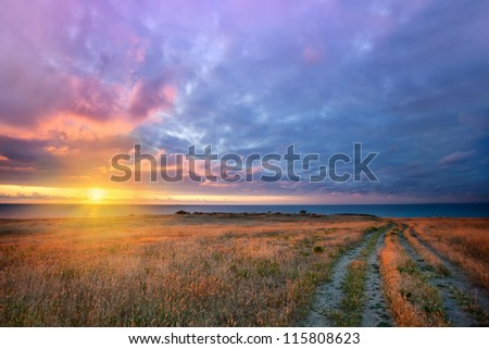 Sunset over road to the sea