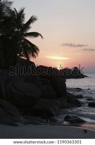 Sunset over rock formations at beach, Anse Takamaka, Mahe', Seychelles
