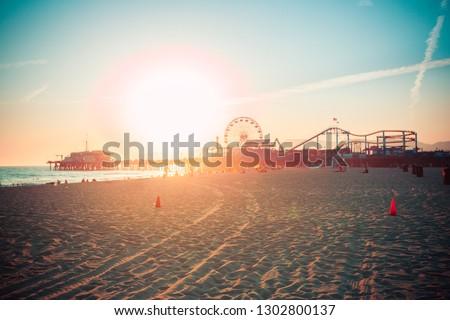 Sunset over Santa Monica beach with famous amusement park vintage retro toned