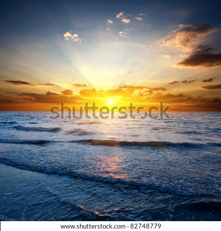Sunset over sea - stock photo