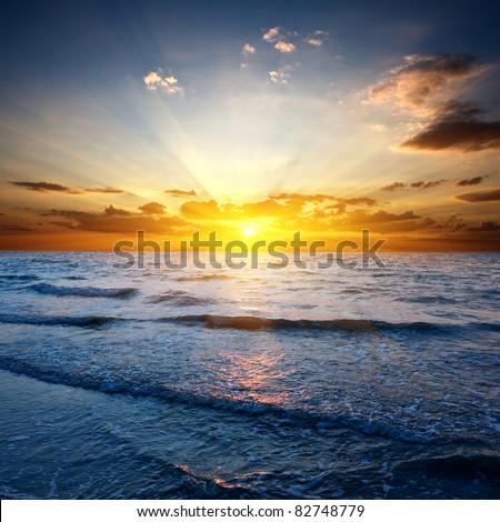 Sunset over sea #82748779