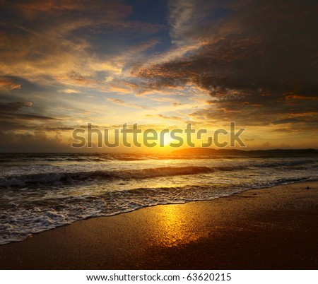 Sunset over sea with clouds