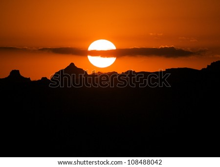 Sunset over the Badlands National Park, skyline silhouette