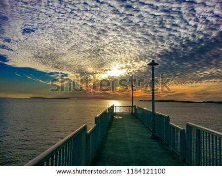 Sunset over the boardwalk at Cedar Key, Florida