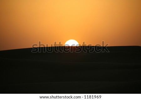Sunset over the desert near Dubai United Arab Emirates - stock photo