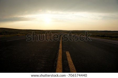 Sunset over the endless road #706574440