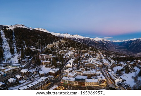 Sunset over the famous Crans-Montana ski resort and village in Canton Valais in the alps mountain in Switzerland Photo stock ©