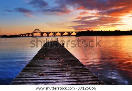 stock-photo-sunset-over-the-famous-landmark-queen-alexandrine-bridge-in-denmark-39125866.jpg