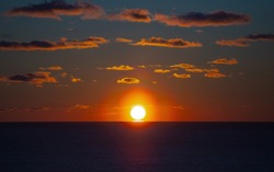 Sunset over the Gulf of Mexico in Panama City Beach Florida in the winter.