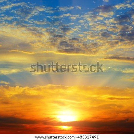 Sunset over the horizon. Sky with colored clouds. #483317491