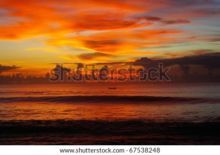 Sunset over the Indian ocean, Dreamland beach, Bali, Indonesia.