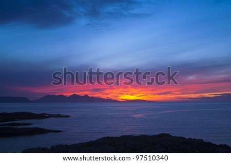 "Sunset over the Inner Hebridean Islands of Eigg and Rum from Portnaluchaig. Photographed from 56° 56' 25.55"" N, 5° 51' 43.64"" W    B8008, Arisaig, Highland PH39, UK"