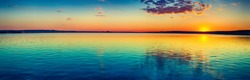 Sunset over the lake in Russia. Amazing landscape panorama