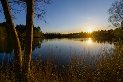 Sunset over the lake in Sherwood Forest