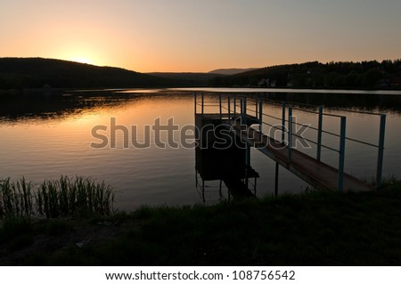 sunset over the lake, landscape image - stock photo