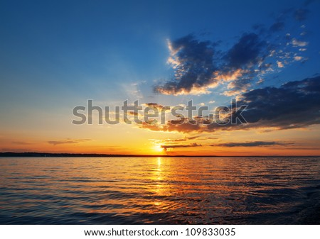 sunset over the lake or sea