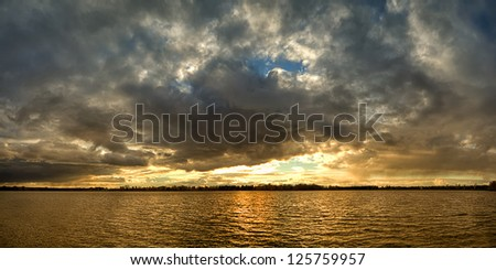 sunset over the lake, the sunset over the water, evening sunset, the sky at sunset, the clouds at sunset, sunset over the cloudy sky,