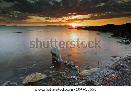 Sunset over the mountains of Jura from the west coast of Kintyre, Scotland