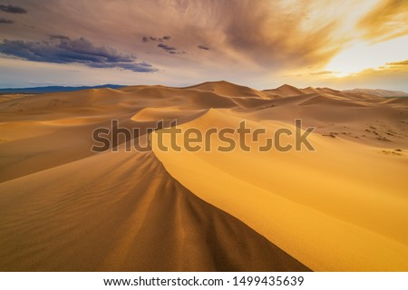 Sunset over the sand dunes in the desert. Death Valley, USA