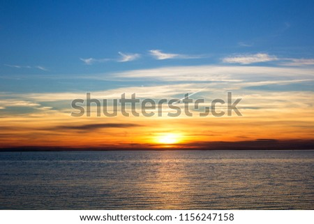 Sunset over the sea #1156247158