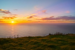 sunset over the sea from a cliff in Ponta do Pargo, Madeira Island