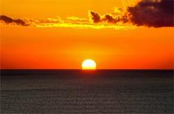 Sunset over the sea horizon