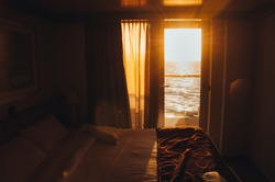 Sunset over the sea seen from inside the cabin of a cruise ship, Italy. Concept: luxury cruise, relaxing holiday