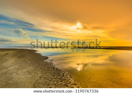 Sunset over the sea with orange sky background #1190767336