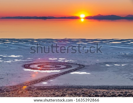 Photo of  Sunset over the Spiral Jetty, a giant earthwork sculpture by Robert Smithson in the Great Salt Lake of northern Utah, United States.