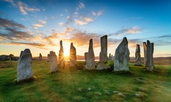 Sunset over the stone circle at Callanish on the Isle of Lewis in Scotland