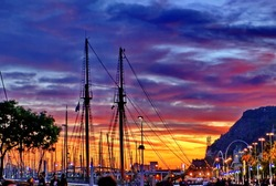 Sunset over the yacht marina at Port Vell, Barcelona, Spain