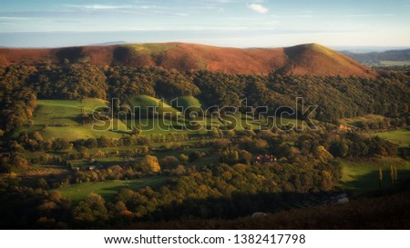Sunset over valley at Church Stretton, Shropshire, England #1382417798