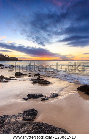 Sunset over Watego's Beach at Byron Bay - stock photo