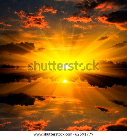 Sunset over water reflection
